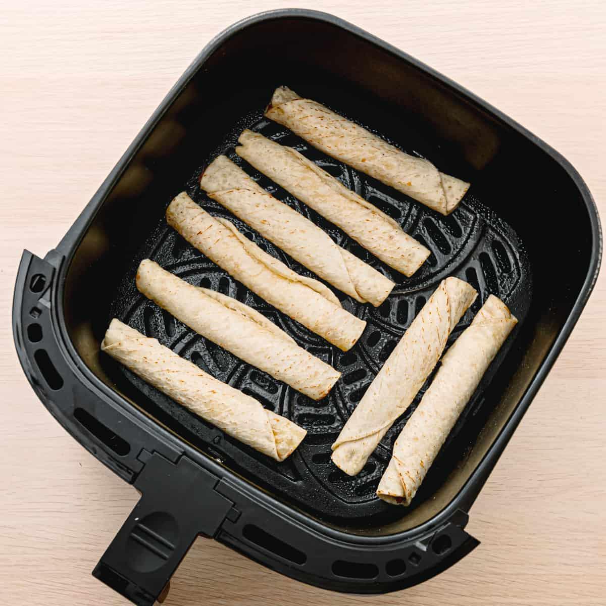 frozen taquitos in an air fryer.